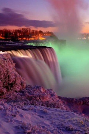 A winter view of the American Falls and Goat Island at Sunset - Niagara Falls, New York