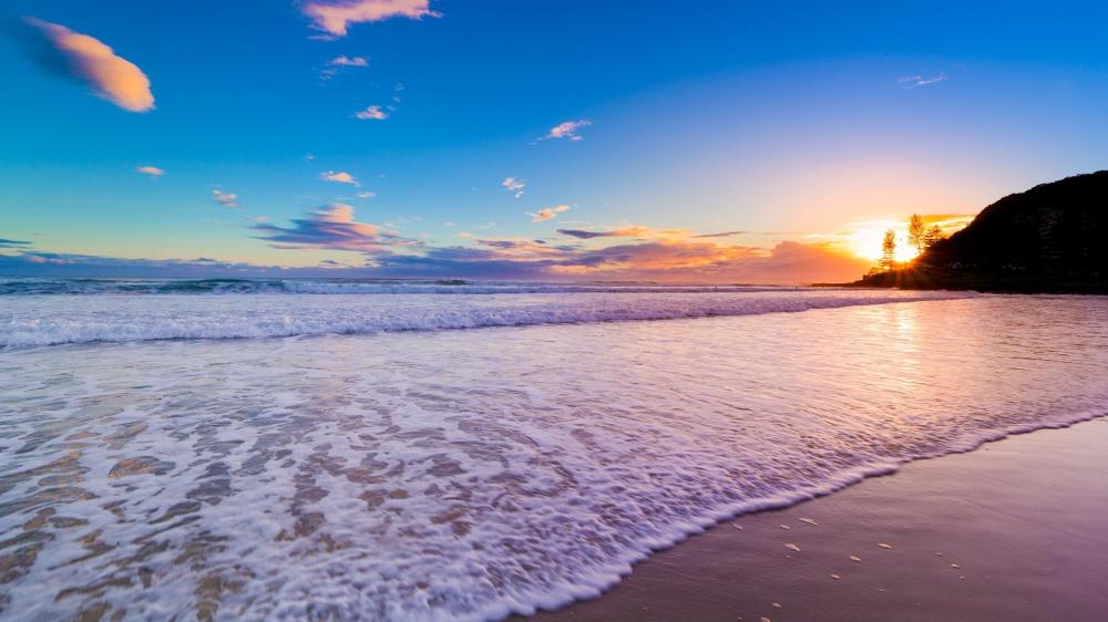 sunset-over-a-beach-wallpaper-53a1a702717fc