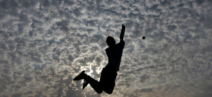 Boys play cricket on the Marina beach in the southern Indian city of Chennai