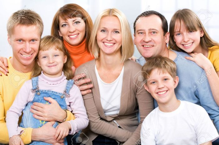 12150856-Happy-large-family-looking-at-camera-Stock-Photo